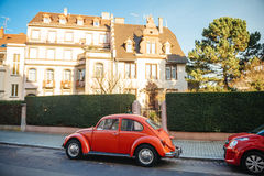 Vintage red Volkswagen Beetle car on the street Royalty Free Stock Images