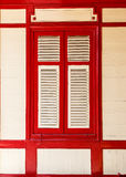 Vintage red and white window on wooden wall Royalty Free Stock Images