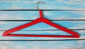 Vintage red wooden hanger Stock Images