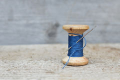 Vintage reel of thread and needle Royalty Free Stock Photo
