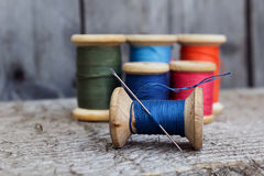 Vintage reels of thread and needle Royalty Free Stock Photography