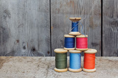 Vintage reels of thread  and needle. Sewing tools Royalty Free Stock Photography