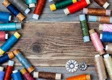 Vintage reels of varicolored thread and old flower buttons Stock Image