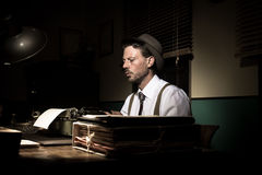 Vintage reporter working late at night Royalty Free Stock Image