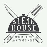 Vintage restaurant logo, badge or emblem. Stock Image