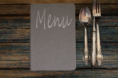 Vintage restaurant menu on a rustic wood background Royalty Free Stock Images