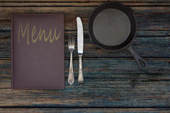 Vintage restaurant menu on a rustic wood background Stock Photos