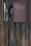 Vintage restaurant menu on a rustic wood background Royalty Free Stock Photography