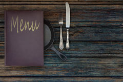 Vintage restaurant menu on a rustic wood background Royalty Free Stock Photos
