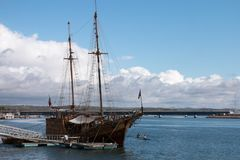 Vintage restored Caravel ship anchored. In the docks of Portimao city, Portugal Stock Images