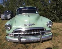 Vintage Restored Chevrolet Sedan. Vintage restored light green Chevrolet sedan Royalty Free Stock Photos