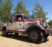 Vintage Restored Tow Truck. Vintage restored red and white tow truck Stock Photos