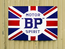 Vintage Retro Advertising Metal Sign, Motor Spirit. A British Petroleum BP Motor Spirit - vintage metal advertising board sign from the 1920s and 1930s Royalty Free Stock Images
