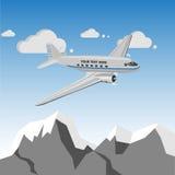 Vintage retro airplane over mountains. Vintage retro piston engine airplane flying over mountains Royalty Free Stock Photos