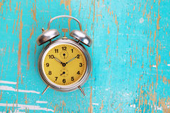 Vintage Retro Alarm Clock on Rustic Blue Background Royalty Free Stock Images