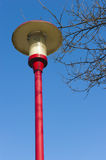 Ancient lamppost at parking of gasstation on highw Stock Photography
