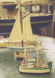 Vintage Retro Antique Toy Boats of Different Sizes on a Desk Stock Images