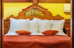Vintage retro bedroom design. Double bed Royalty Free Stock Photo
