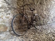 Vintage retro bicycle leaning against a stone wall. Retro bicycle, leaning against a stone wall in an old street in Florence stock images