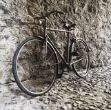 Vintage retro bicycle leaning against a stone wall. Retro bicycle, leaning against a stone wall in an old street in Florence royalty free stock photos