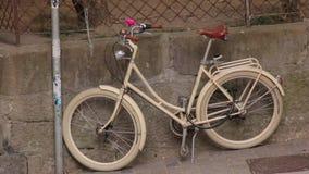 The vintage retro bike. The vintage retro beige bike with flower stock video