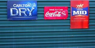Vintage retro billboards Coca Cola Carlton beer. Vintage retro billboard of Coca Cola at a green wall in Stuarts Well. Along the Stuart Highway, Australia Royalty Free Stock Photography