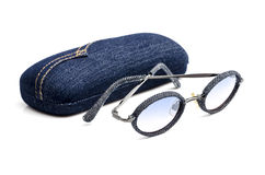 Vintage retro blue jeans  sunglasses with eyeglass case  isolated on white. Royalty Free Stock Image