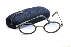 Vintage retro blue jeans  sunglasses with eyeglass case  isolated on white. Royalty Free Stock Photo