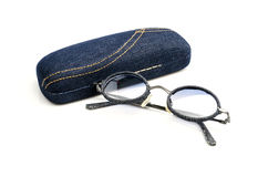Vintage retro blue jeans  sunglasses with eyeglass case  isolated on white. Stock Image