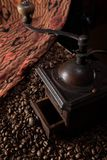 Vintage, retro bronze coffee mill on black background stock photography