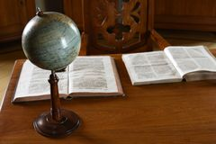 Vintage Retro Table with Globe and Books royalty free stock photos