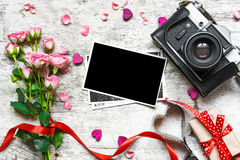 Vintage retro camera on wood table background with blanks photo. Royalty Free Stock Image