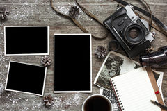 Vintage retro camera on wood table background covered with snow Royalty Free Stock Photo