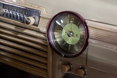 Vintage retro car dashboard with analog clock and audio radio system with buttons, handmade with wood and chrome for. Restoration royalty free stock photos