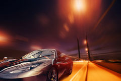 Vintage retro car on the road. Royalty Free Stock Image