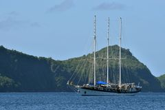 Vintage retro classic old sailboat sailing on dark blue ocean. Travel, vacation, voyage, tropical paradise trip, adventure, tourism concept Stock Image