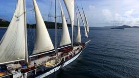 Vintage retro classic old sailboat sailing on dark blue ocean. Travel, vacation, voyage, tropical paradise trip, adventure, tourism concept Stock Photos