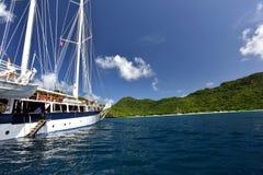 Vintage retro classic old sailboat sailing on dark blue ocean. Travel, vacation, voyage, tropical paradise trip, adventure, tourism concept Stock Photo