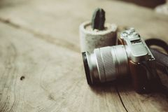 Vintage retro design mirrorless digital camera still life with grain noise effect. Vintage retro design mirrorless digital camera still life on wood background royalty free stock photography