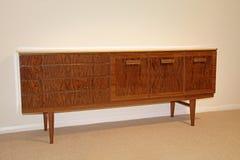 Vintage retro dresser sideboard. Photo of an original 1960/70's vintage retro sideboard dresser in mahogany finish Stock Image