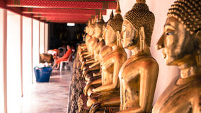 Vintage retro effect filtered hipster style image of Buddha gold statue and thai art architecture in wat pho Royalty Free Stock Photos