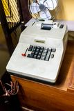 Vintage retro electric adding machine on wooden table royalty free stock image