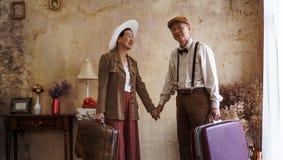 Vintage retro fashion Asian senior couple travel luxury trip aft. Er retirement royalty free stock photos