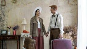 Vintage retro fashion Asian senior couple travel luxury trip aft. Er retirement stock photo