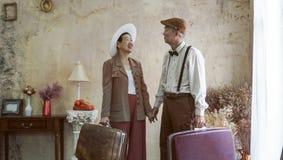 Vintage retro fashion Asian senior couple travel luxury trip aft. Er retirement stock images