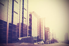 Vintage retro filtered picture of modern downtown. Stock Photos