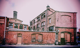Vintage retro filtered picture of old abandoned building. Royalty Free Stock Photo
