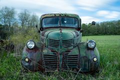 Vintage / Retro Green Dodge Truck - New York. A vintage / retro green Dodge truck sits abandoned in a junkyard in western New York stock photography