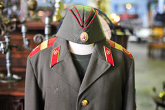 Vintage retro hat and dress of general soldier military after wa. The vintage retro hat and dress of general soldier military after war Royalty Free Stock Photo