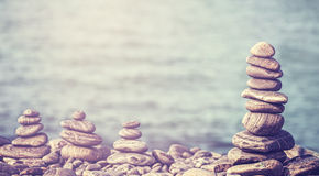 Vintage retro hipster style image of stones on beach. Royalty Free Stock Image